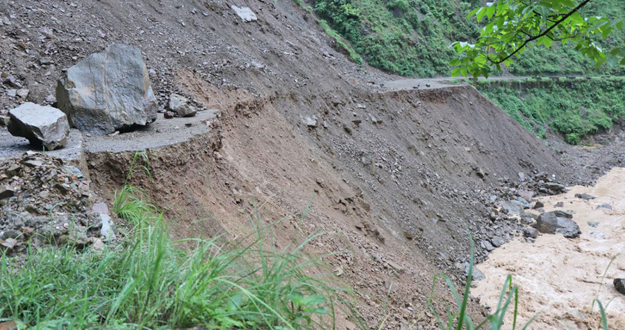 Landslides, floods block almost three dozen of road sections across country